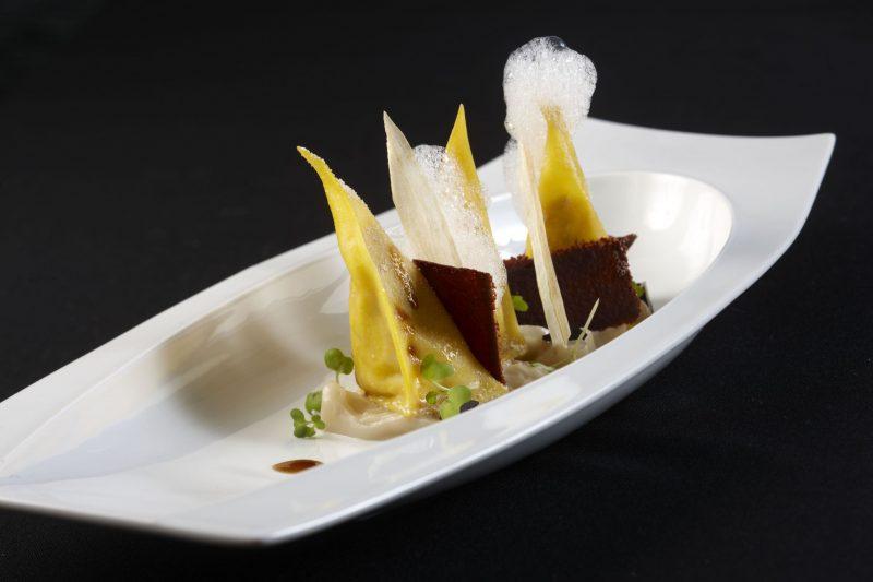 Ravioli, stufato alla genovese di maialino nero casertano, scorzonera, cioccolata e birra
