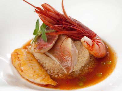 Zuppa di pesce di scoglio con zoccolo di cous cous di frumento timilia all'olio di tonda iblea